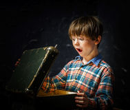 Little boy finding treasure Stock Photography
