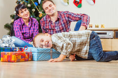 Little boy finds a Christmas presents under the tree Stock Images