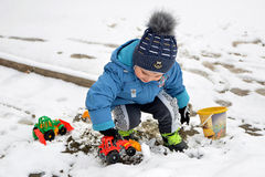 Little boy and first snow Royalty Free Stock Photo