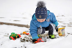 Little boy and first snow Stock Images