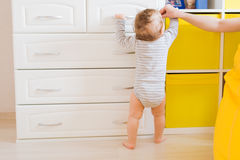 Little boy first steps with the help of mother. Little boy first steps with the help of mom stock photography