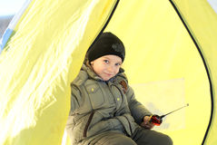 Little boy fishes in a tent Stock Photography