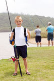 Little boy fishing. Happy little boy fishing with grandpa and brother Royalty Free Stock Photography