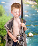 Little boy with fishing equipment Royalty Free Stock Photos