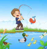 Little boy fishing Stock Photos