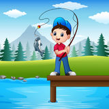Little boy fishing in the river Royalty Free Stock Photos