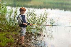 Little boy with fishing rod Stock Photography