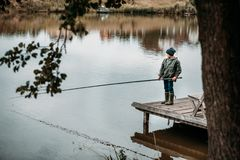 Little boy fishing with rod Stock Image