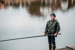 Little boy fishing at lake Royalty Free Stock Photo