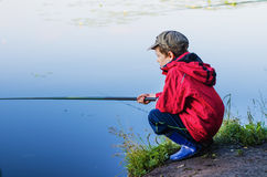 Little boy on fishing Royalty Free Stock Photos