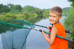 Little boy fishing. Summer vacation - Photo of little boy fishing on the river Royalty Free Stock Photo