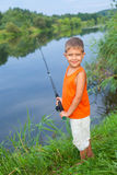 Little boy fishing. Summer vacation - Photo of little boy fishing on the river Royalty Free Stock Image
