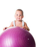 Little boy with the fitness ball Stock Image