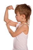 Little boy flexing biceps Stock Images