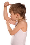 Little boy flexing biceps Royalty Free Stock Image