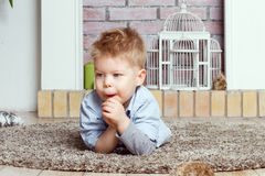 Little boy on a floor. Little boy lies on a floor Royalty Free Stock Images