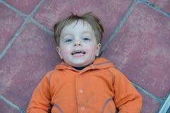 Little boy on the floor Royalty Free Stock Photo