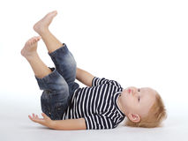Little boy on the floor. Photo of little funny boy on the floor Stock Image