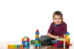 Little boy on the floor with toys Royalty Free Stock Photography
