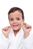 Little boy flossing teeth Royalty Free Stock Photo