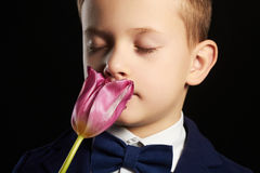 Little boy with flower.stylish kid Stock Photo