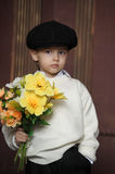 Little Boy with flowers Royalty Free Stock Photo
