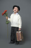 Little Boy with flowers Stock Images