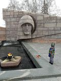 Little boy with flowers on the holiday of May 9 the day of victory in Second world war USSR near monument to unknown soldier royalty free stock photos