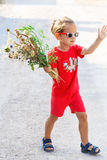 Little boy with flowers Stock Photos