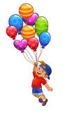 Little boy is flying on balloons Royalty Free Stock Photography