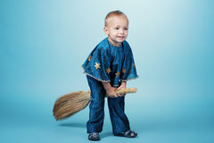 Little boy flying on broom Royalty Free Stock Photo