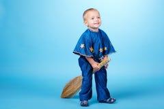 Little boy flying on broom Royalty Free Stock Photo