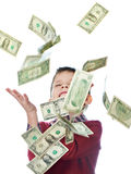 Little boy and flying dollar bills isolated Royalty Free Stock Image
