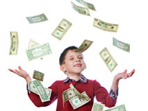 Little boy and flying dollar bills isolated Royalty Free Stock Photo