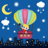 Little boy flying in a hot air balloon. Royalty Free Stock Images