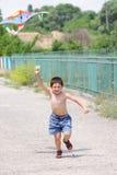 Little boy flying kite Stock Images