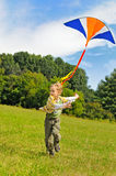 Little boy flying a kite Royalty Free Stock Images
