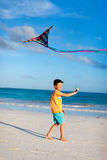 Little boy flying a kite Royalty Free Stock Photography