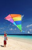 Little boy flying a kite on beach Royalty Free Stock Photos