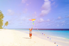 Little boy flying a kite on tropical beach Royalty Free Stock Image