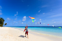 Little boy flying a kite on tropical beach Royalty Free Stock Photography