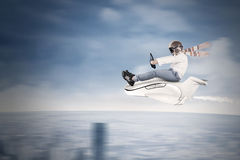 Little boy flying on small aircraft Stock Photo