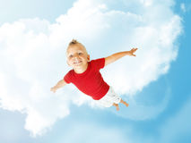 Little boy flying up into the sky