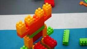 The little boy is following Lego. stock video