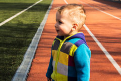 Little boy on football field face expression Stock Photography
