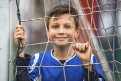 Little boy on the football stadium. Football. Royalty Free Stock Image
