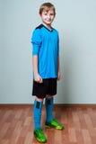 Little boy in football uniform smiling Stock Image