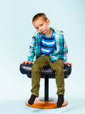 Little boy and footstool Royalty Free Stock Images