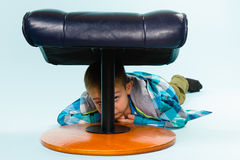 Little boy and footstool Royalty Free Stock Photos