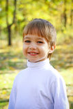 Little boy in the forest Stock Photo